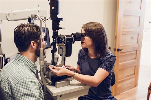 Dr. Mulanix examining a patient.