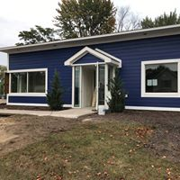 You can't miss us with our new blue siding!