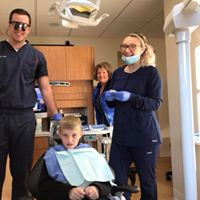 Dr. Dan, Assistant Emma and Front Desk Debbie with Downtown Dental's first patient!
