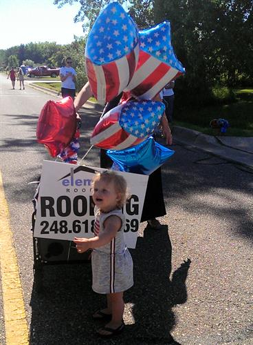 Element Roofing's adorable helper in the parade.