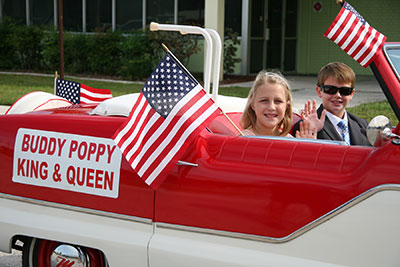 Buddy Poppy King and Queen in the Annual Veteran's Day Parade