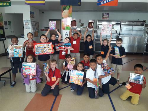 Ruskin students with rewards earned from the At-Home reading initiative
