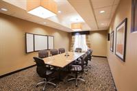 Dedicated Board Room with a White Board and LCD TV.