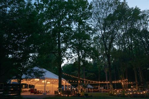 The venue at night! Our beautiful custom tent to provide space for up to 200 guests.