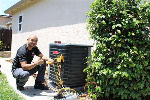 Lead Service Technician, Gilbert Caceres installing a new HVAC system in Antioch, CA