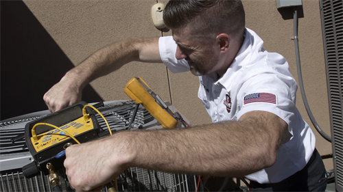 Owner, Chris Donzelli servicing a client's air conditioning unit in Brentwood, CA