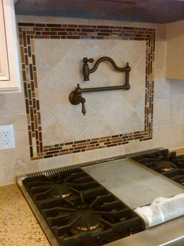 Ceramic backsplash behind stove