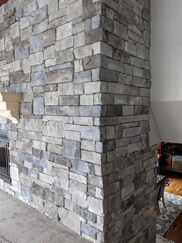 Stacked Stone Fire place Wall Side View between floor levels.