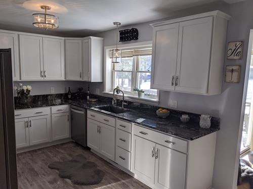 Remodel that kitchen at home. White Shaker Cabinets, Granite Counter Tops always a nice change.