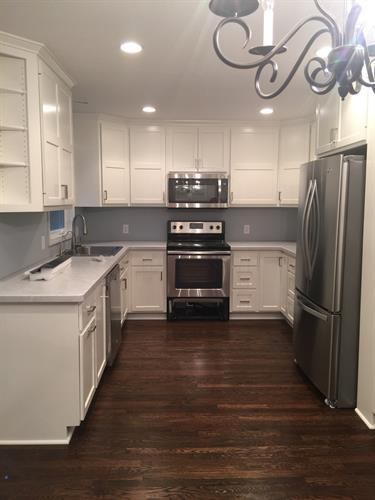 Painted White Kitchen,  Laminate Countertops, Oak Floors