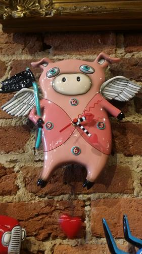 Who says pigs can't fly?   Large selection of funky & unique clocks.