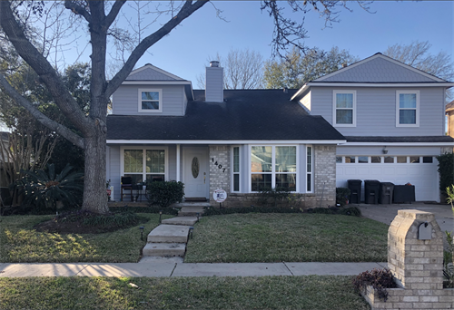 James Hardie Siding and Vinyl replacement windows with grids