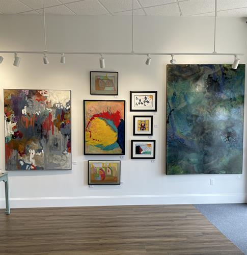Abstract acrylics Dana Finimore left, Amy Frisby right, Robin Martea prints