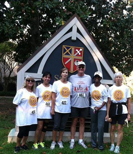 Firm employees at he Sun King Memorial 5K Run & Walk and One Mile Fun Run, hosted by St. James' Episcopal Church of Jackson.