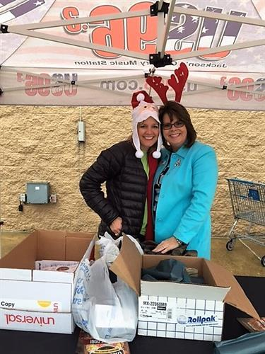 Agents Clancy Walker and Judy Rogers at the Stuff the Truck for the Salvation Army