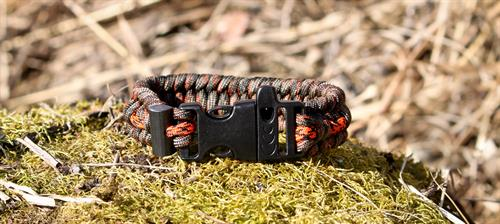 The other side of the Alaska Survival Bracelet showing the whistle buckle and military grade firesteeel