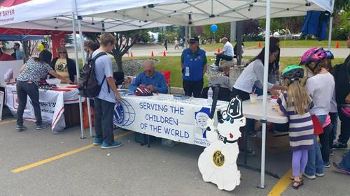 Kiwanis donates bicycle helmets to give away every year at Bear Paw