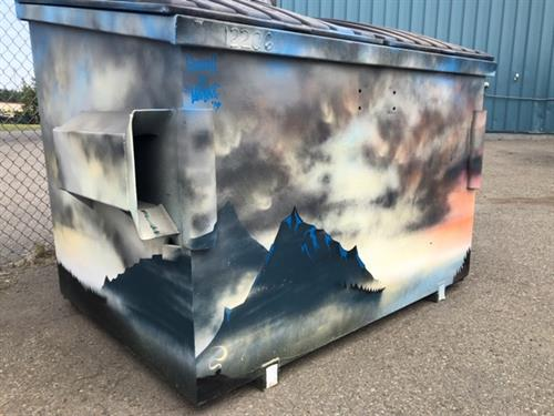 A dumpster painted by Blaines Art Supply.