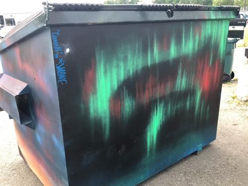 The back of a dumpster, painted by Blaines Art Supply.