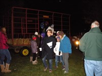 Families enjoy the haunted prairie hayride at Halloween at the Farm.