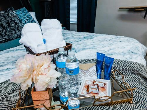 Masculine bedroom welcome basket on your bed