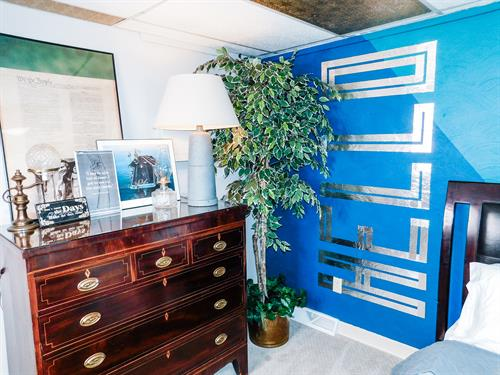Masculine bedroom dresser and welcome wall