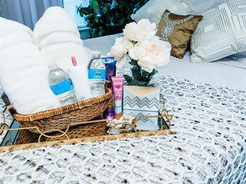 Feminine bedroom welcome basket on your bed