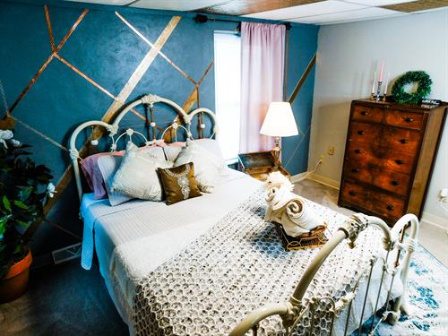 Feminine bedroom bed and accent wall