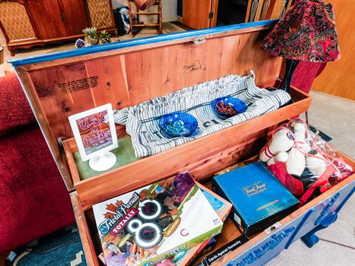 Chest of various board games in the reading nook