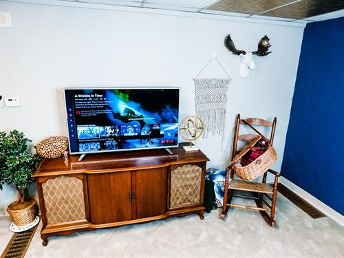 """Vintage TV stand with a new 50"""" Smart TV"""