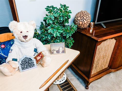 """One of the owner's late wife's Teddy Bear on a vintage school desk. Be sure to read """"Robin's Teddy Bear Story"""" on the AirBNB website or while visiting."""