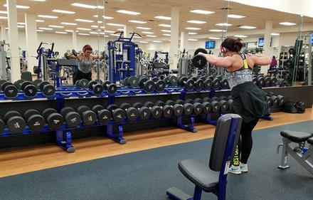 One of our members utilizing the dumbbell rack.