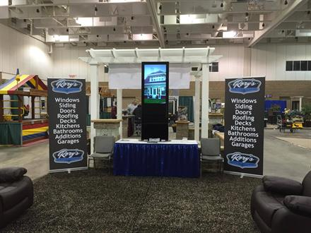 Rory's Home Improvement Home Show setup with Retractor Banners and Digital Kiosk