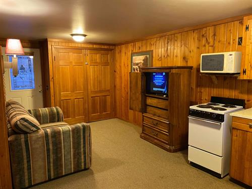 "Unit 2 has a pull-down murphy bed in the living room and will sleep 4. It has a 32"" TV with Directv."