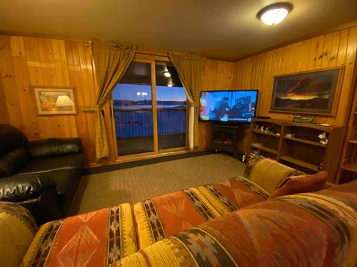 "The Getaway Suite (unit 8) has a sliding glass door to the back balcony, an electric fireplace/heater, and a 50"" flat screen TV with Directv."