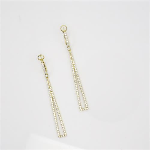 Combining two hot trends; shoulder duster earrings & geometric shaped jewelry!