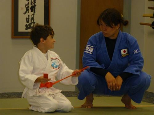 Andrew spending some time with Ms. Aiko Sato, 2011 World Champion.