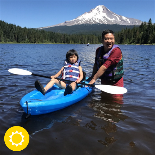 Summit Academy staff and student kayaking for the first time, on Trillium Lake.