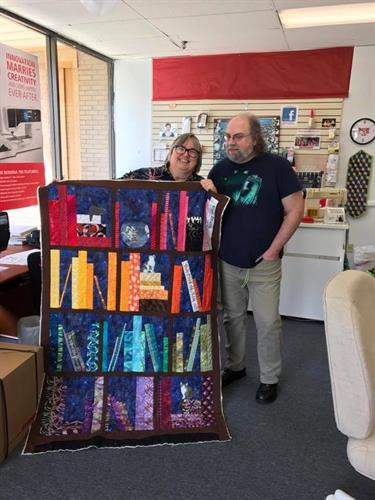 Owners Cathy & Mike displaying a quillow in progress