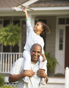 Gallery Image father-daughter_house-exterior_shoulders-airplane_227x288.jpg