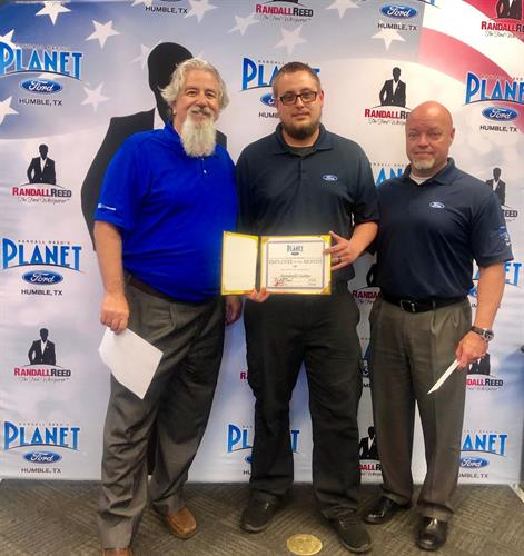 General Manager John Centner and Director of Fixded Operations with Employee of the month for May 2019.