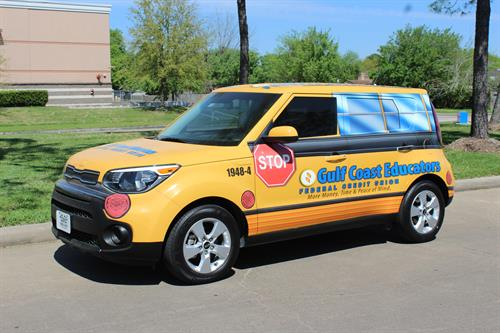 You may see our mini bus around town.