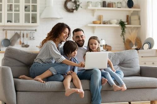 Gallery Image family_on_couch_w_laptop.jpg
