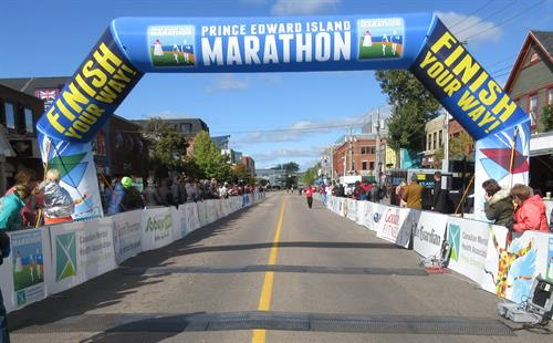 Imagine Finishing under the PEI Marathon arch