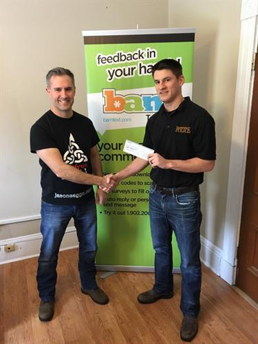 BamText Owner, Keir Pollard, presenting a cheque to Joel Robichaud