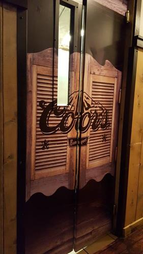 Creatively dressing up old kitchen doors at a local bar/restaurant.