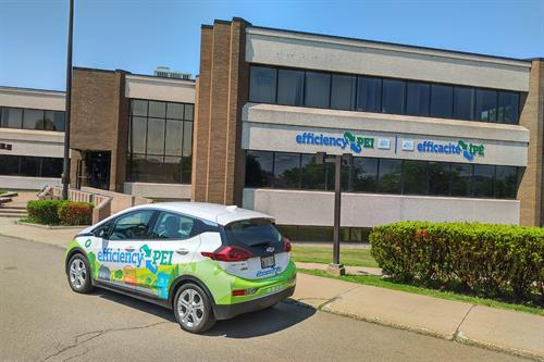 The electric vehicle parked outside of the efficiencyPEI Charlottetown office