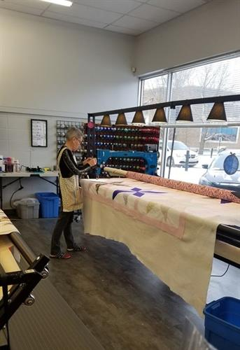 Lucy on the Long Arm Quilting Machine