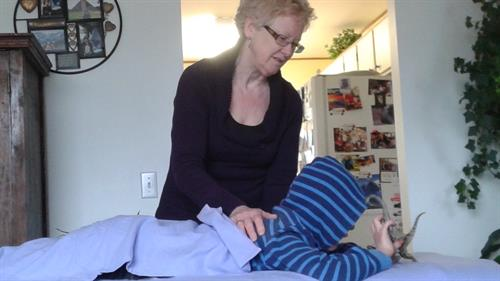 Giving Reiki to a young boy with Autism