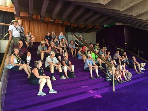 Listening to a guided tour at the Sydney Opera House (Australia)